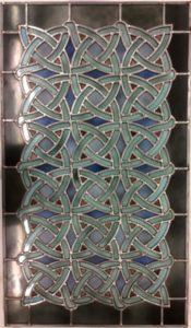 Ce vitrail cistercien a été entièrement réalisé par l'un de nos membres (Luc Coisman), qui est venu découper les morceaux de verres avec le couteau oscillant monté sur notre fraiseuse CNC